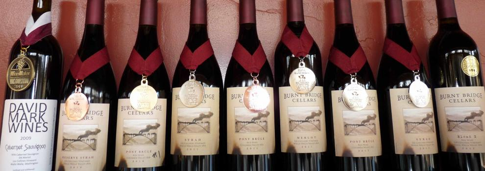 Bottles of Burnt Bridge wine, each wearing a medal.